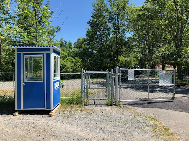 4x4 Security Guard Booth in Ellenville NY, with Sliding Windows, Anchoring Brackets, and perimeter security fencing