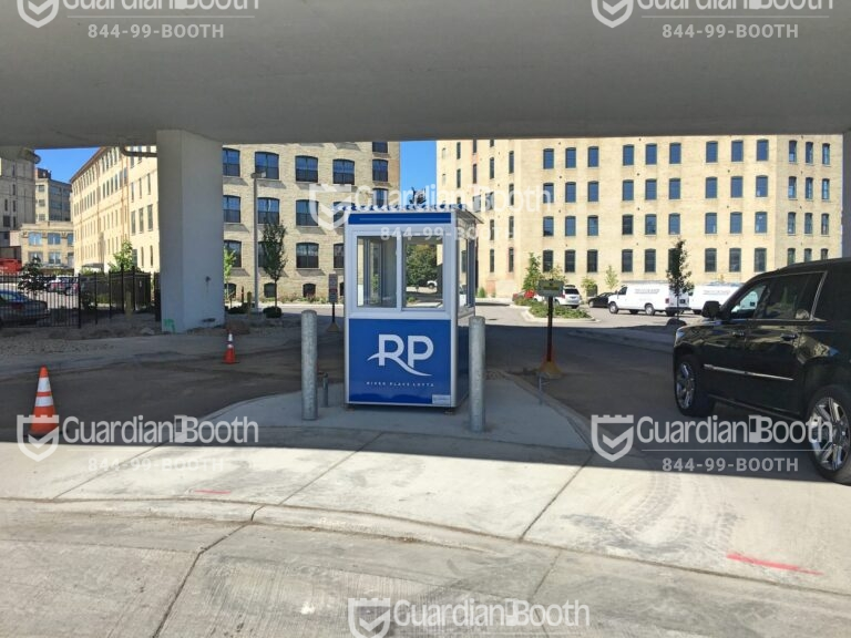 4x4 Security Guard Booth in Milwaukee, WI Outside of Apartment Complex with Sliding Windows, Custom Graphics, and Swing Door