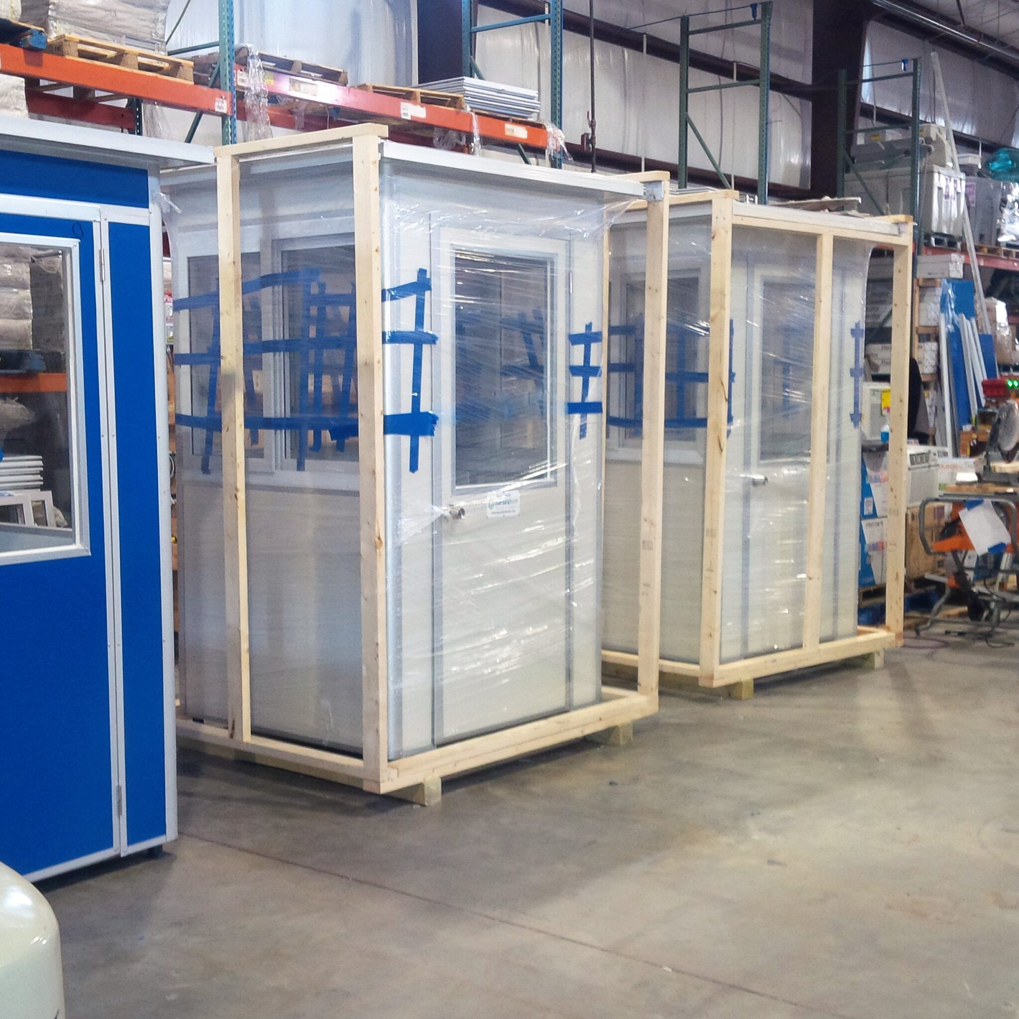 4x4 Security Guard Booths ready for Delivery in Guntersville, AL with Custom Exterior Color, Swing Door, and Sliding Windows