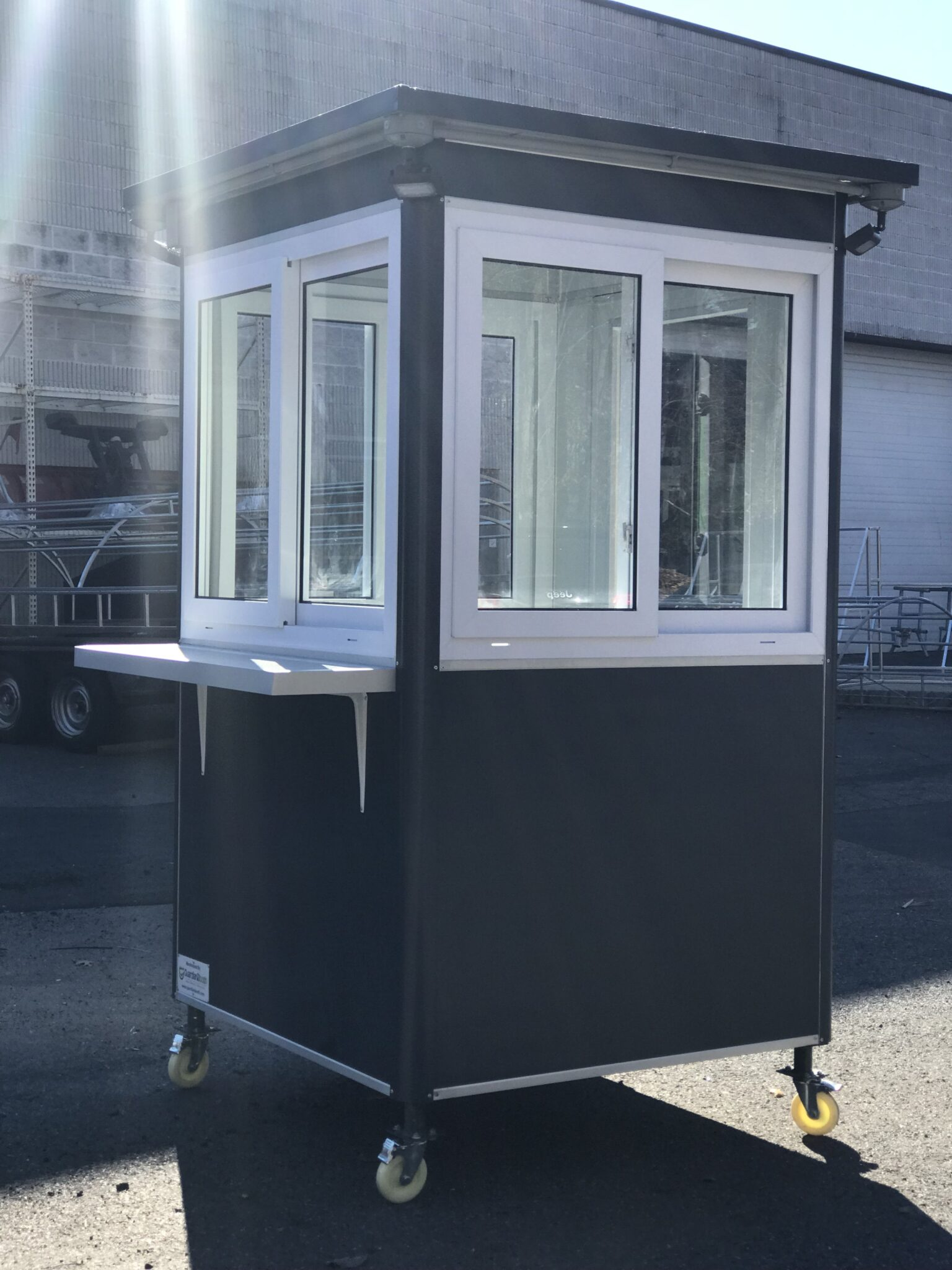 4x4 Ticket Booth in Carlsbad, CA with Caster Wheels, Exterior Counter, and Outside Spotlights