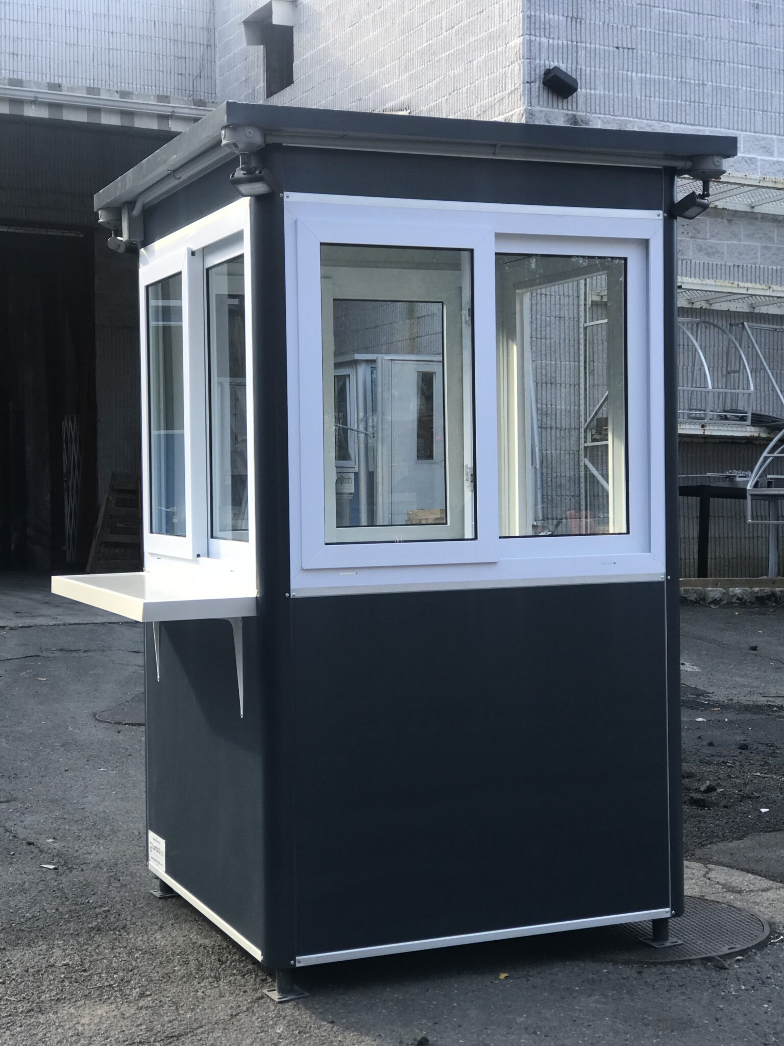 4x4 Ticket and Cashier Booth in Bronx, NY with Custom Exterior Vinyl Wrap, anchoring brackets, exterior desk and floodlights