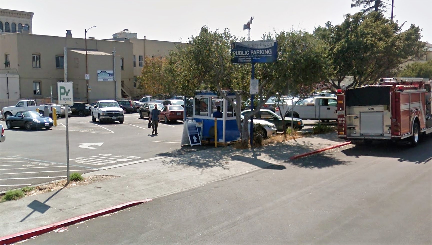 4x6 Parking Booth in Berkeley, CA in Parking Lot with Tinted Windows, Swing Door, Sliding Windows, and Breaker Panel Box