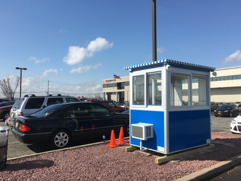 4x6 Parking Booth in Elizabeth, NJ outside warehouse with Outside Spotlights, Built-in Ac, Baseboard Heaters, and Breaker Panel Box