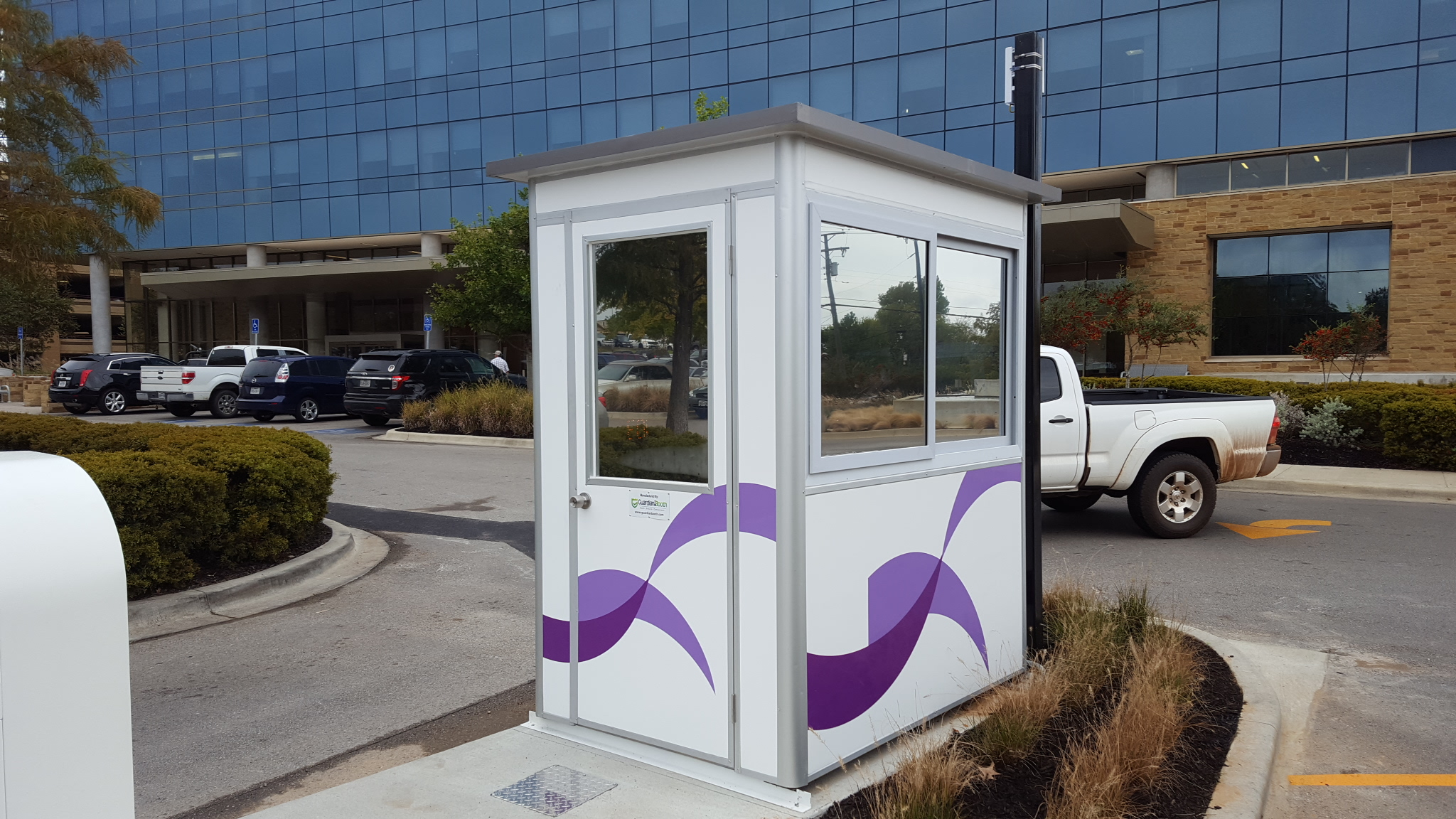 4x6 Parking Booth in Tyler, TX outside a clinic with Swing Door, Custom Graphics, Tinted Windows, and Custom Exterior Color