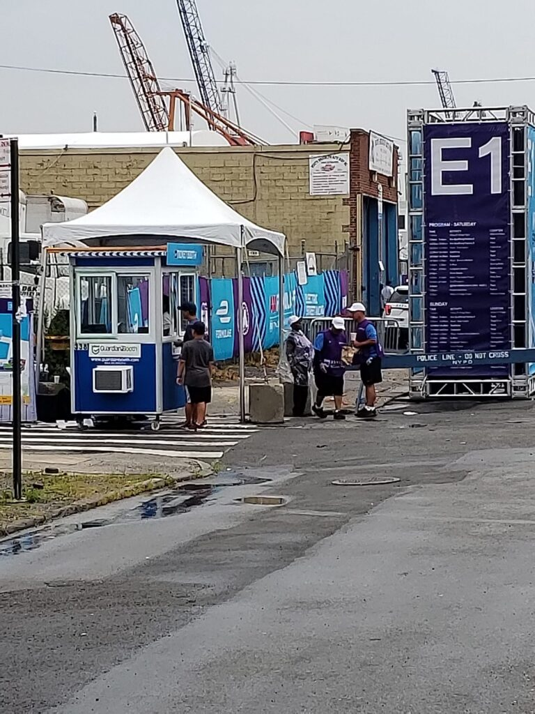 4x6 Ticket Booth in Brooklyn, NY at E-Prix underneath tent with Caster Wheels, Built-in AC, Sliding Windows, and Swing Door