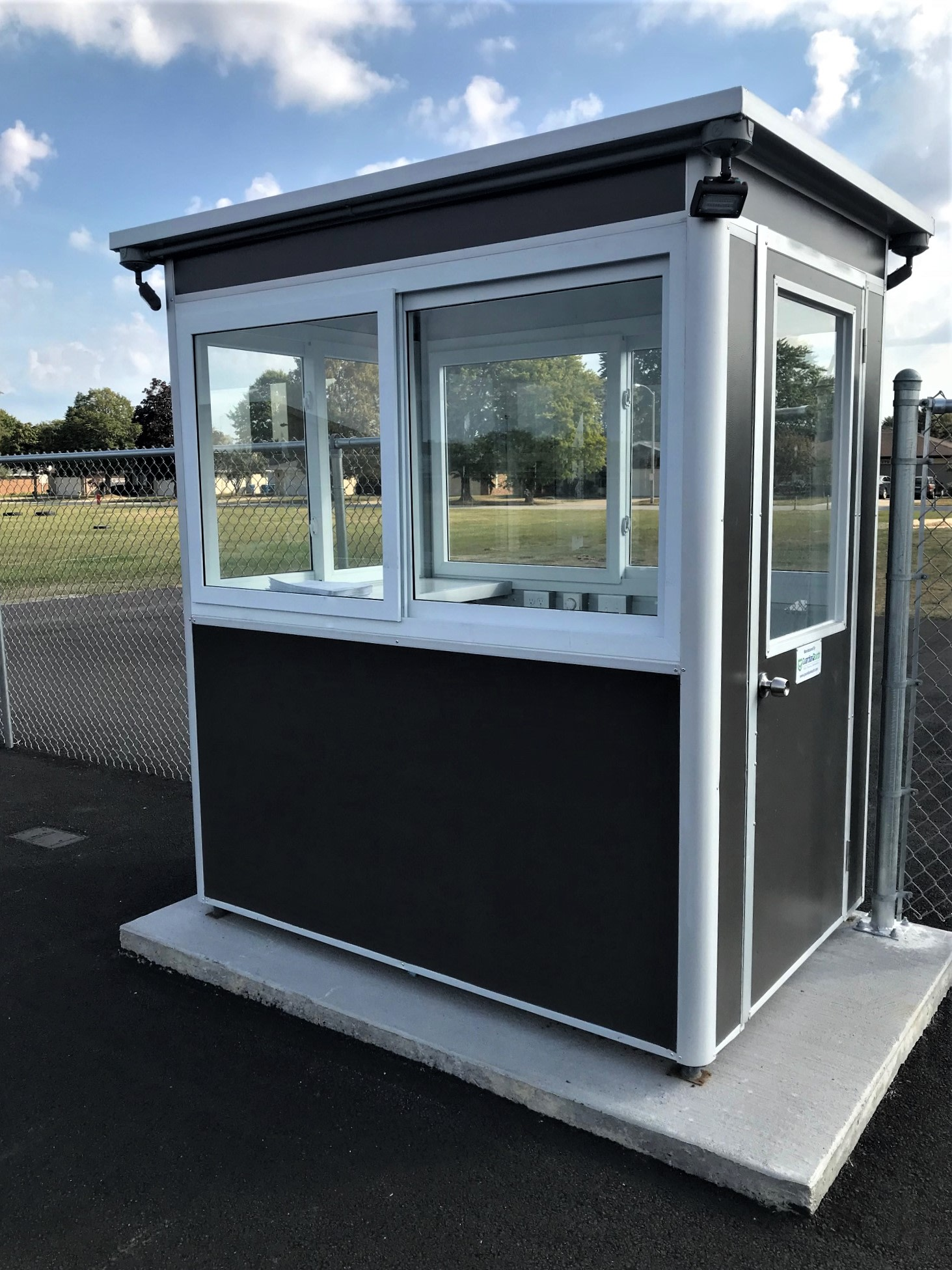 4x6 Ticket Booth in Harvey, IL with Custom Exterior Color, Outside Spotlights, Anchoring Brackets, Baseboard Heaters, and Built-in AC