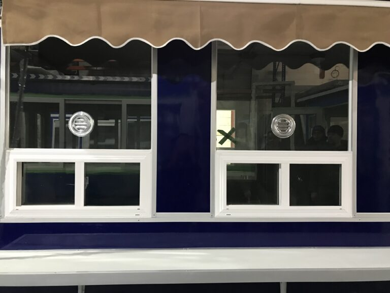 6x16 Booth with Add-On Features Ticket Transaction Windows, Speakers, Sliding Windows, Exterior Counter, and Retractable Awning
