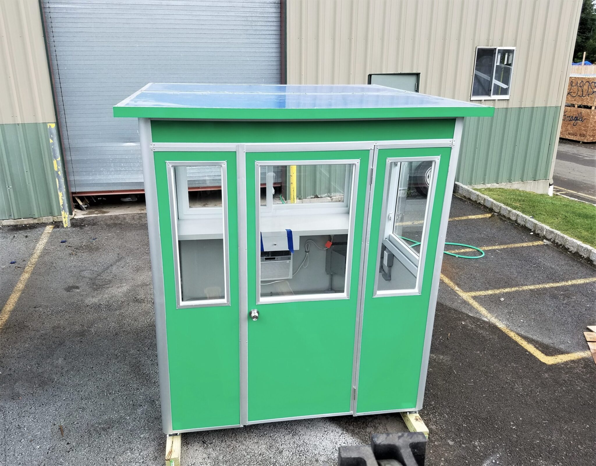 6x6 Hospital Security Booth in Charlotte, NC with Custom Exterior Vinyl Wrap and Desk with Drawer