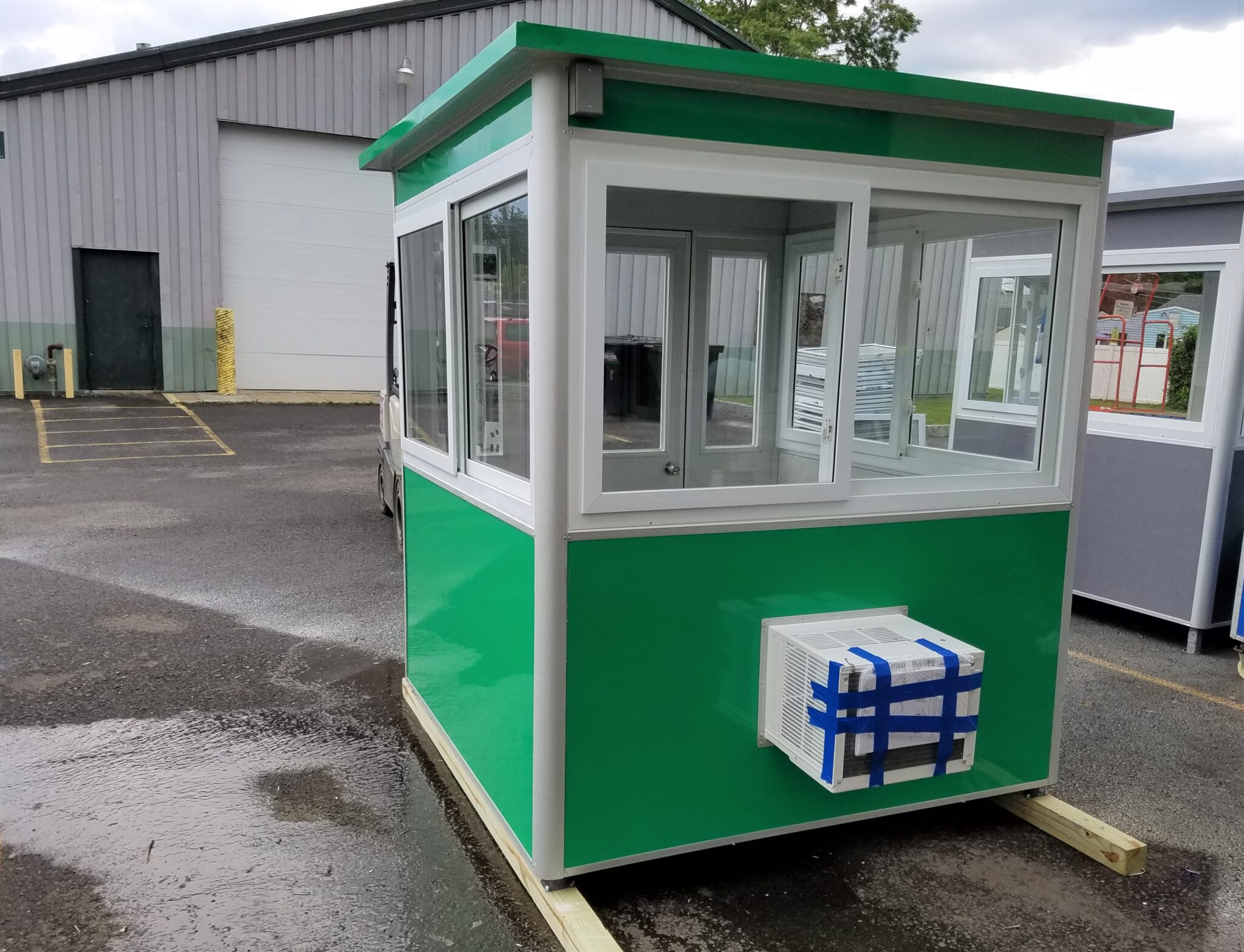6x6 Parking Booth in Charlotte, NC with Built-in AC, Baseboard Heaters, Sliding Windows, Swing Door, and Anchoring Brackets