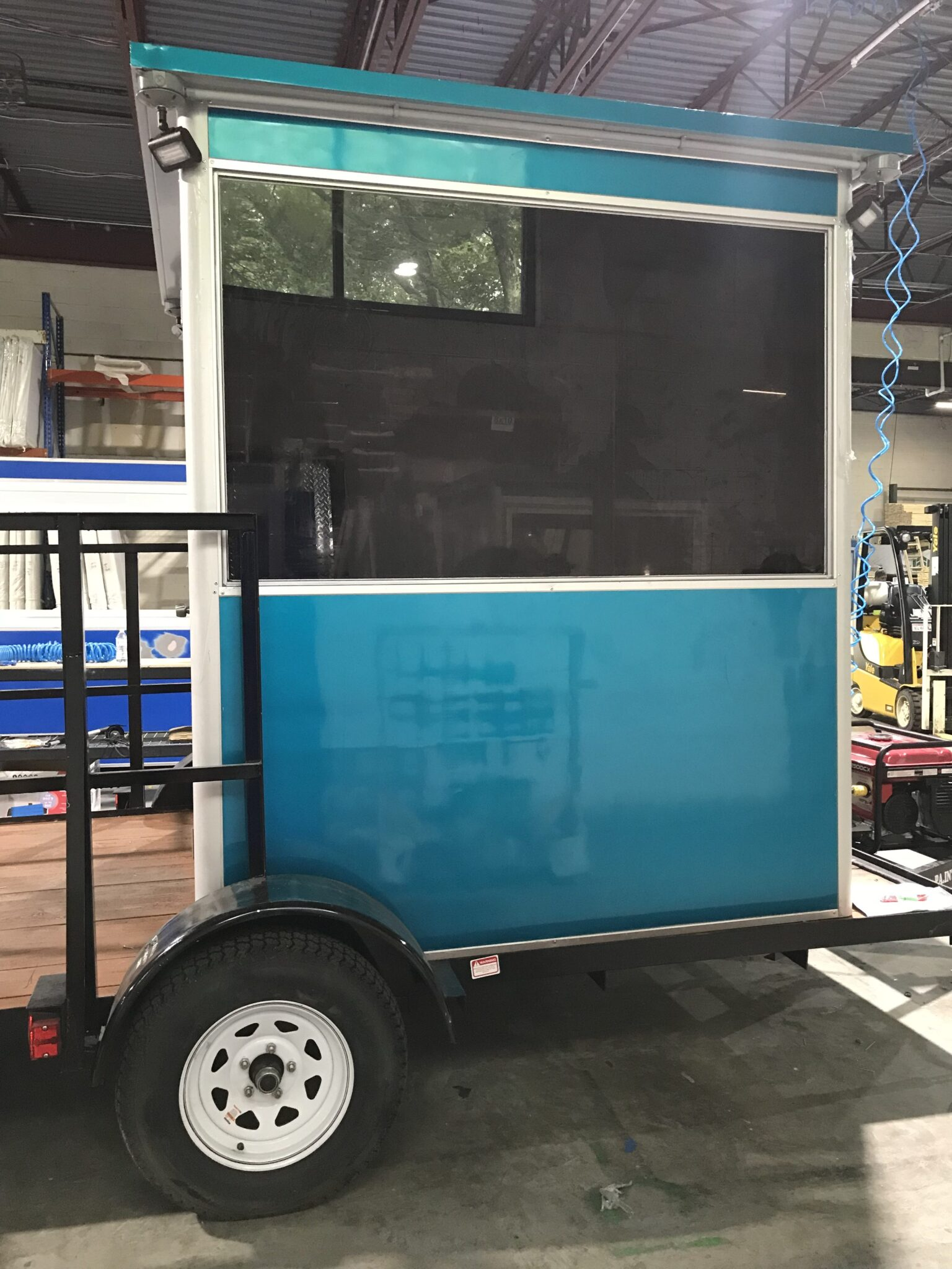 6x6 Trailer Booth in Chalk River, Ontario with Tinted Windows, Outside Spotlights, Custom Exterior Color