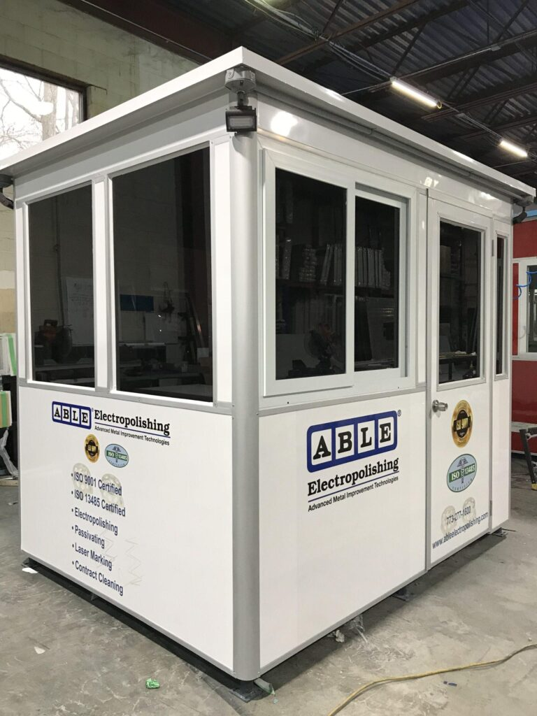 6x8 Security Guard Booth in Chicago, IL with Custom Graphics, Custom Exterior Color, Tinted Windows, Outside Spotlights,and Built-in AC