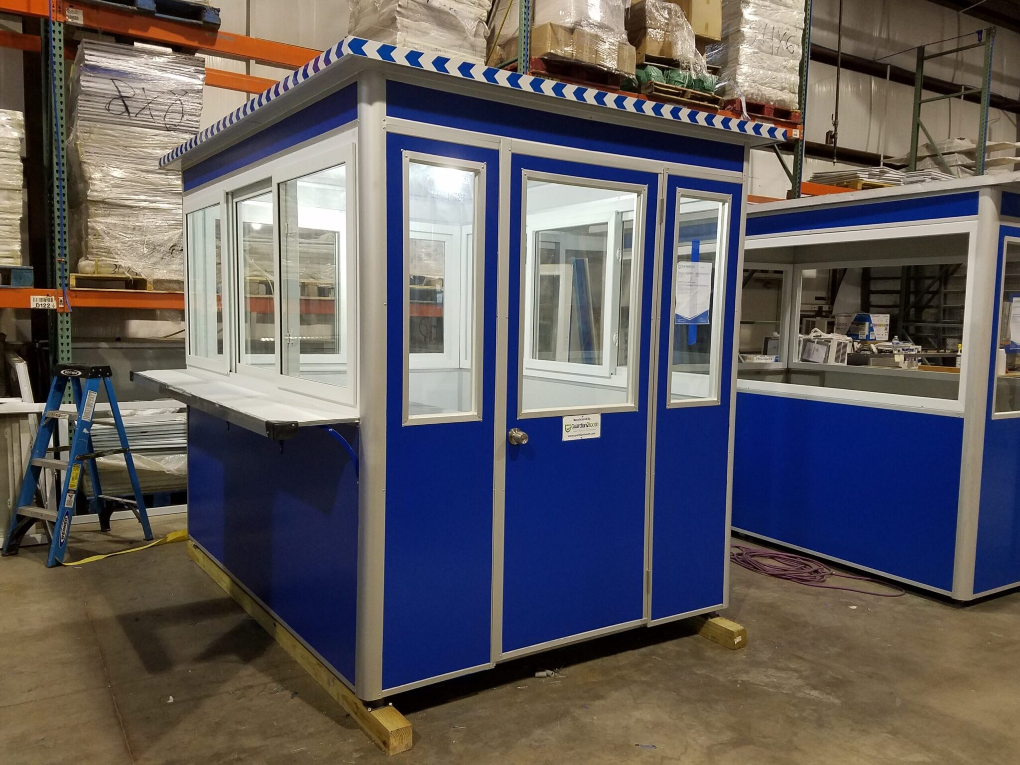6x8 Ticket Booth in Binghamton, NY with Exterior Ticket Counter, Sliding Windows, Swing Door, and Exterior Electrical Disconnect Switch