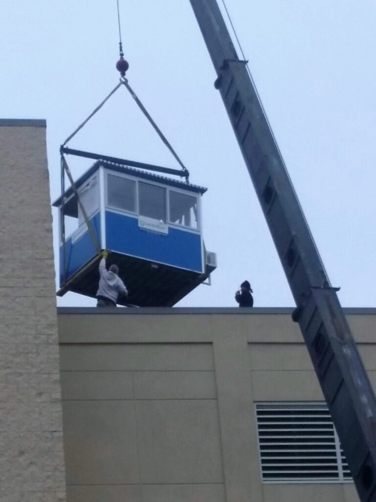 6x8 on crane approaching roof