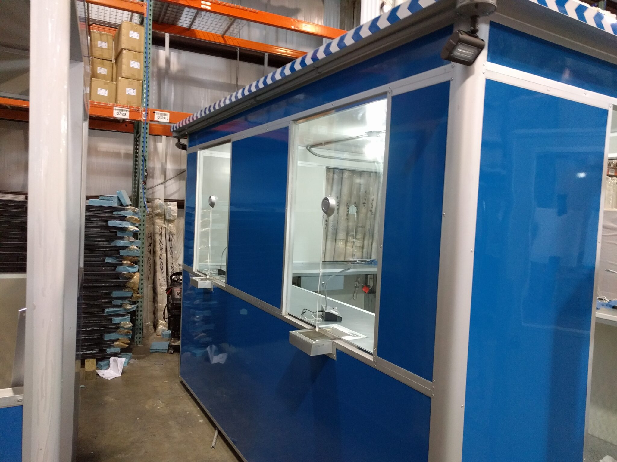 8x10 Booth with Add-On Features Ticket Transaction Windows, Speakers, Outside Spotlights, and Sliding Windows