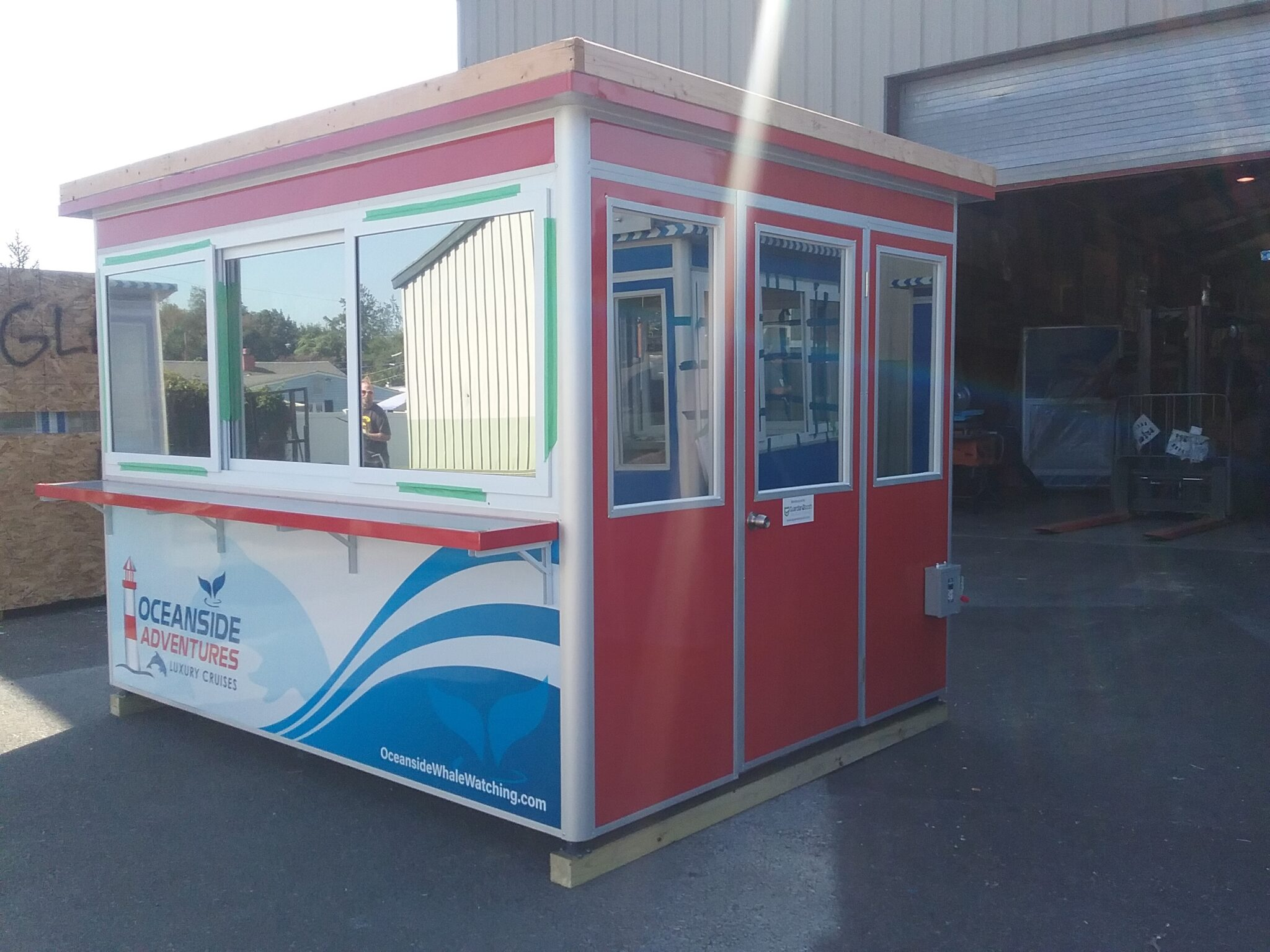 8x10 Ticket Booth in Oceanside, CA with Custom Graphics, Tinted Windows, Anchoring Brackets, and Ethernet and Phone Line