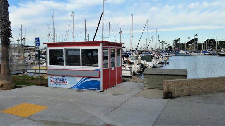 8x10 Ticket Booth in Oceanside,CA outside Harbor with Exterior Foldable Counter, Tinted Windows, Custom Graphics