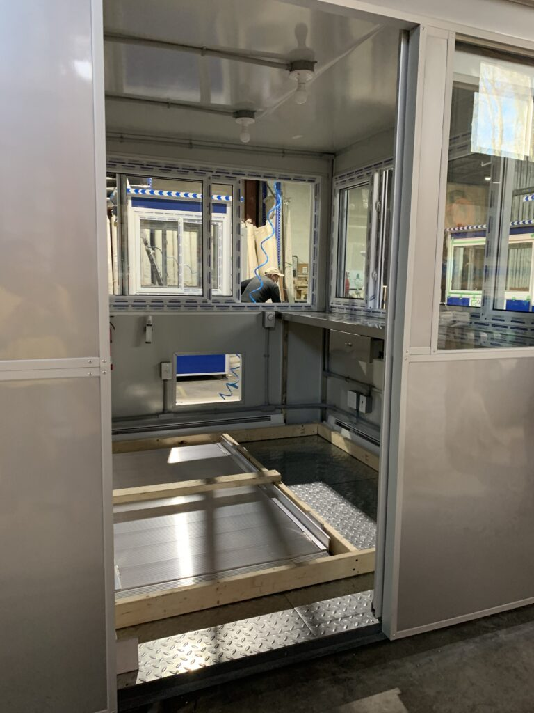 8x12 Security Guard Booth in Talladega, AL with ADA Ramp, Sliding Door, and Custom Exterior Color