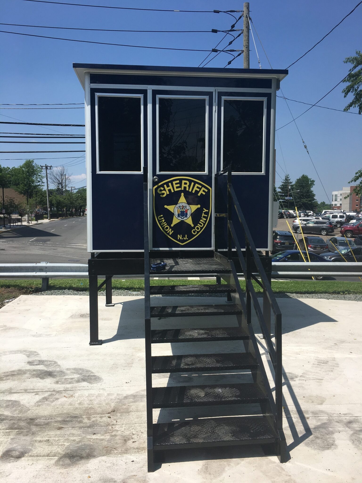 8x8 Security Guard Booth in Elizabeth, NJ with Mezzanine, Swing Door, Custom Exterior Color, and Breaker Panel Box