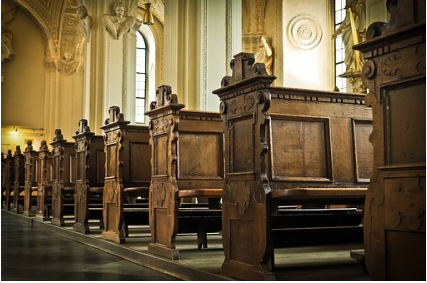 Inside an empty house of worship with pews