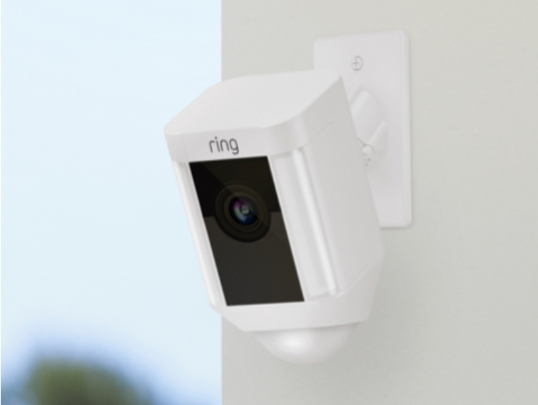 A white Ring video camera on a white wall