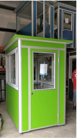 A green guard booth in a warehouse