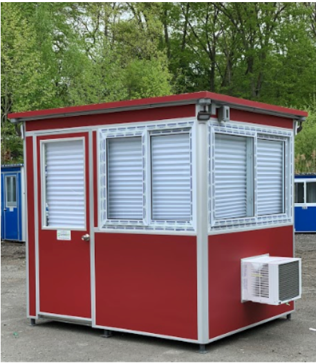 A red guard booth with closed blinds