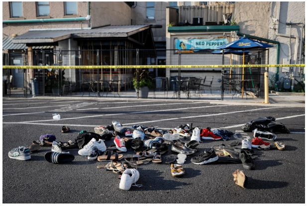 shoes piled up near the site of the Dayton, Ohio shooting, August 4, 2019