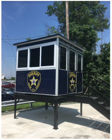 Blue Sheriff's guard booth on platform