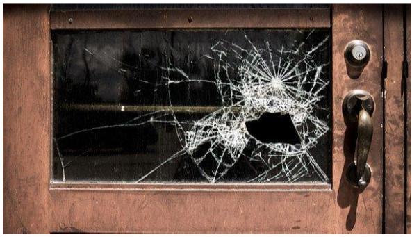 Broken glass on an old door