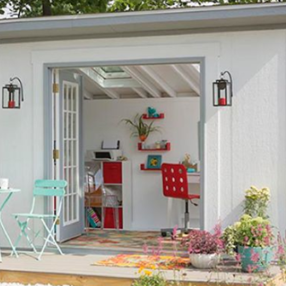 Airy she shack with open doors and red accents