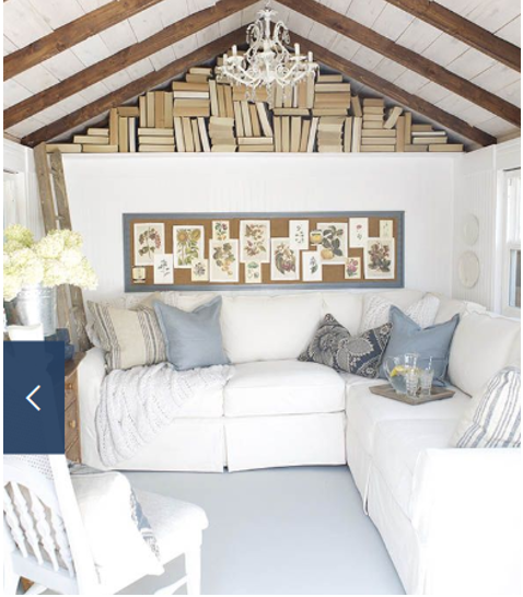 Inside a she shack with wood walls and white couch