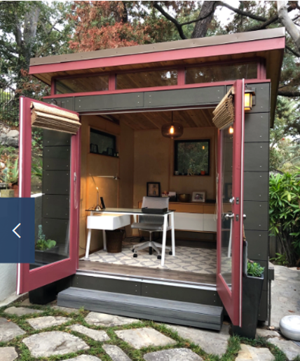 She shack with pink trim and open French doors