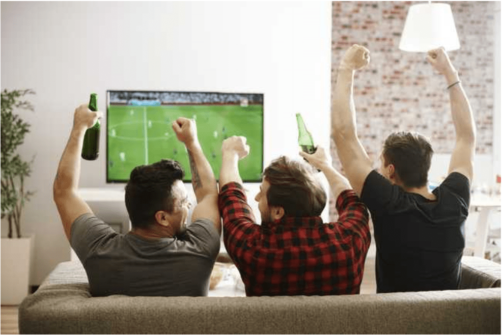 men cheering in a man cave shed
