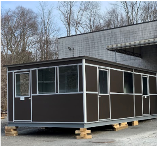 Large, brown, modular outdoor office building