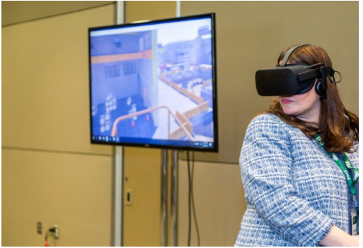 Woman with VR glasses and a VR screen