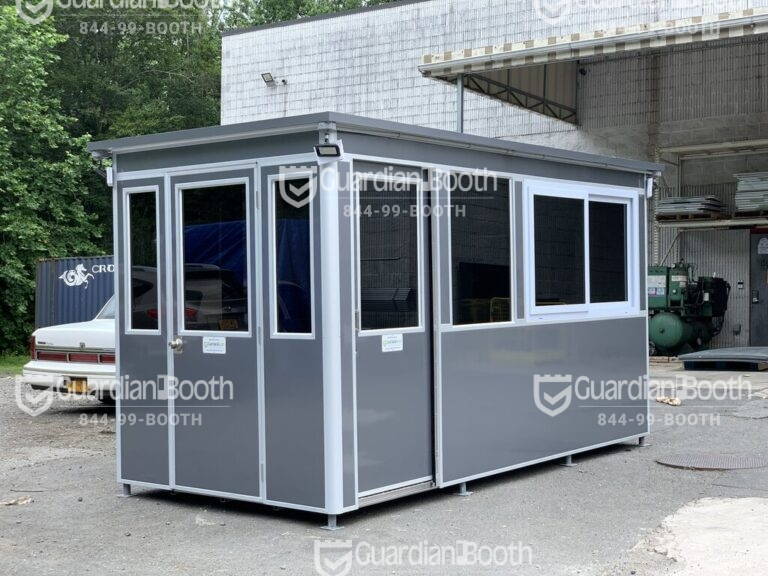 7x14 Construction Site Booth in Franklin IN with Sliding Door with Fixed Window, Tinted Windows, Custom Vinyl Wrap, Outside Spotlights, Exterior Panel Box, Anchoring Brackets 1