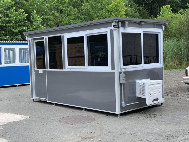 7x14 Construction Site Booth in Franklin IN with Sliding Door with Fixed Window, Tinted Windows, Custom Vinyl Wrap, Outside Spotlights, Exterior Panel Box, Anchoring Brackets