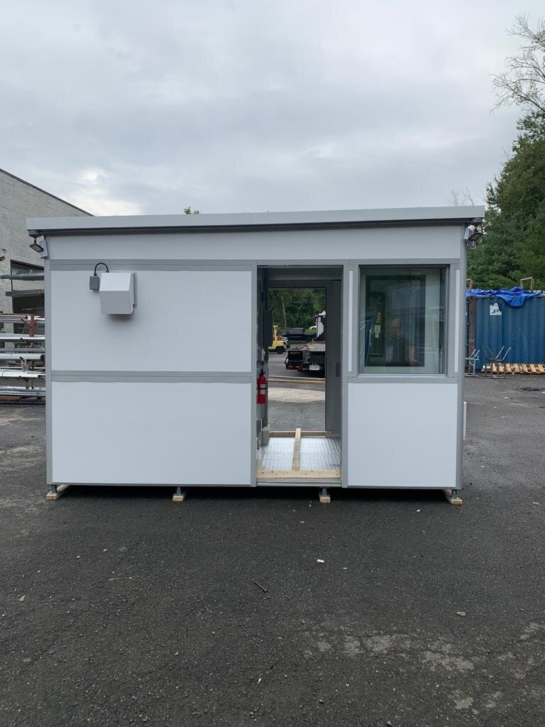 8x12 Security Guard Booth in Springfield, OH with Siding Doors, Custom Exterior Wrap, Restroom, Safety Package, Breaker Panel Box and Built-in AC