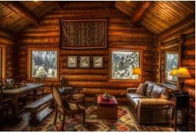 Inside a furnished wood log cabin
