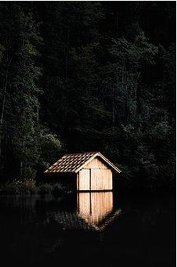Small cabin on a dark lake