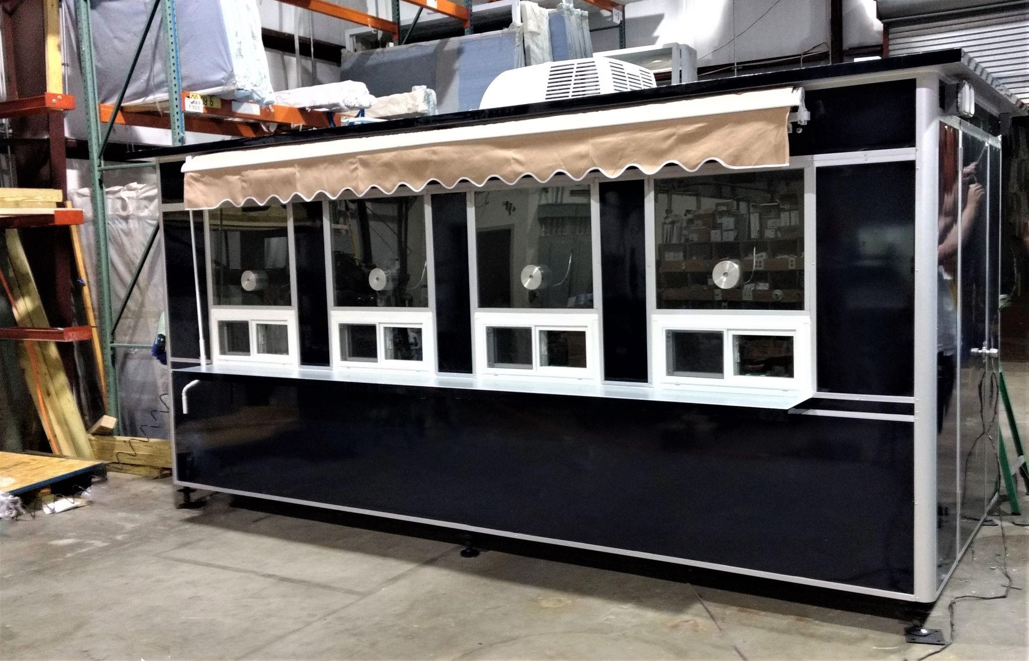 Outdoor customer service booth with awning